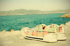 Sport shoes. A pair of sport shoes on the beach Royalty Free Stock Images