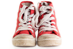 Sport shoes. An old worn pair of children's sports shoes/trainers on a white background stock images