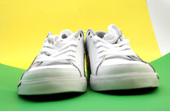 Sport shoes. Pic of pair of sport shoes , on a color back Stock Photo