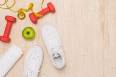 Free Sport Shoes And Water With Set For Activities On Wooden Floor. Royalty Free Stock Images - 122017239