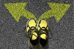 Sport shoes and arrows. On asphalt background stock images