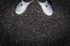 Sport Shoes on Asphalt. Sports Shoes on Old Asphalt Stock Image