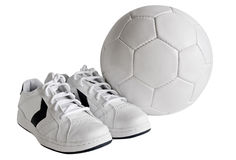 Sport shoes and ball. Sport leather shoes and ball, isolated, clipping path included stock image