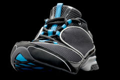 Sport shoes on black Royalty Free Stock Photography