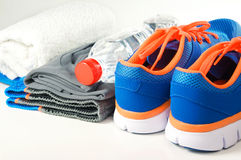 Sport shoes with clothing Royalty Free Stock Photos