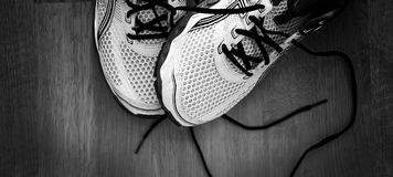 Sport shoes. Detail photo of a pair of shoes. Black and white photo Stock Photos