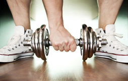 Sport shoes and dumbbell, Stock Photo