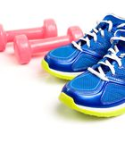 Sport shoes and dumbbell isolated Royalty Free Stock Photos