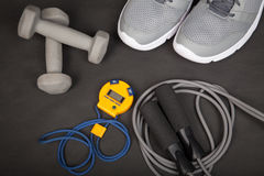 Sport shoes, dumbbells, skipping rope and digital stopwatch. Top view. Fitness, sport and healthy lifestyle concept. royalty free stock photography