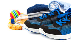 Sport shoes, equipment and measuring tap. Royalty Free Stock Photography