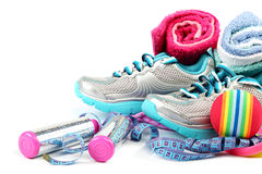 Sport shoes, equipment and measuring tape. Royalty Free Stock Photography