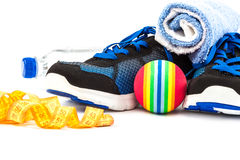 Sport shoes, equipment and measuring tape. Stock Image