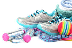 Sport shoes, equipment and measuring tape. Stock Images
