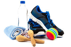 Sport shoes, equipment on a white background. Royalty Free Stock Photo