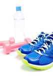 Sport shoes and exercise equipment Royalty Free Stock Photography