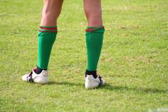 Sport shoes on the field. Rugby team player Royalty Free Stock Photos