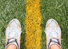 Sport shoes on filed. Sport shoes on football filed Stock Image