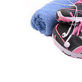 Sport shoes fitness concept. Sport shoes with towel fitness concept on white isolated background Stock Photos