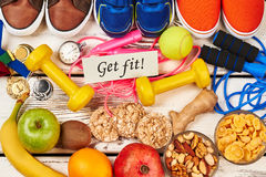 Sport shoes, fruits and dumbbells. Royalty Free Stock Photography