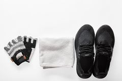 Sport equipment set. Sport shoes, gloves and towel on white background Royalty Free Stock Photography