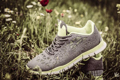 Sport Shoes in Grass Royalty Free Stock Photography