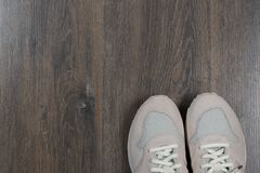Sport shoes on gray floor at home royalty free stock photography
