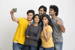 Cheerful group of Indian young friends taking selfie Stock Photo