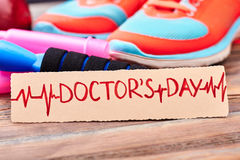 Sport shoes and jump rope. Royalty Free Stock Photography