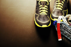 Sport shoes, measuring tape and water Stock Image