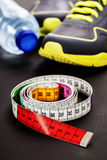 Sport shoes and measuring tape Royalty Free Stock Photo