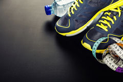 Sport shoes, measuring type and water Stock Images