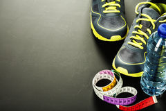 Sport shoes, measuring type and water Royalty Free Stock Photos
