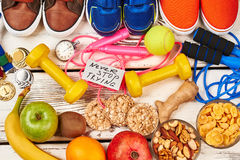 Sport shoes and organic food. Royalty Free Stock Photos
