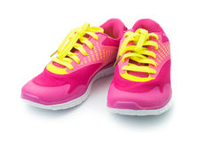 Sport shoes. Pair of pink sport shoes on white background Stock Images