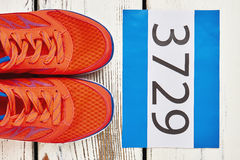 Sport shoes and participant number. Success is our goal Royalty Free Stock Image