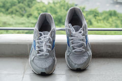 The sport shoes. Put on the balcony Stock Images