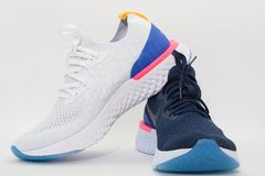 Sport shoes for running ,two colors on white background royalty free stock photo
