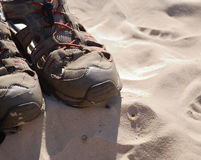 Sport shoes on the sand Royalty Free Stock Image