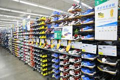 Sport shoes sell in the shop , Sport shoes area in Decathlon store. Sport shoes zone of Decathlon store from shanghai, china Royalty Free Stock Photos