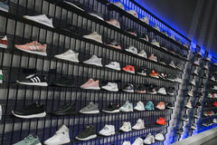 Sport shoes on shelves in Adidas sports shop Royalty Free Stock Image