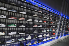 Sport shoes on shelves in Adidas sports shop Royalty Free Stock Photo