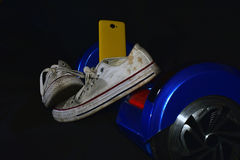 Sport shoes on skate. Dirty shoes on skate and mobile Stock Image