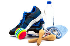 Sport shoes, towels, ball and water bottle Royalty Free Stock Images