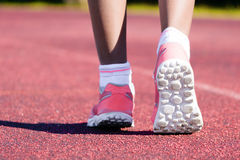 Sport shoes walking Close-up. Close up of women sport shoes walking outdoors royalty free stock photo