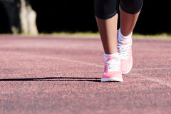 Sport shoes walking Close-up. Close up of women sport shoes walking outdoors royalty free stock image