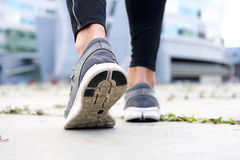 Sport shoes walking outside. Low angle rear sport shoes walking outside Royalty Free Stock Images