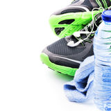 Sport shoes and water bottle. Fitness concept Stock Photography