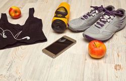 Sport shoes and water bottle with sports equipment Stock Image
