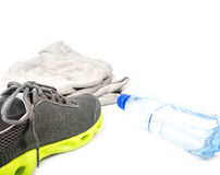 Sport shoes and water Royalty Free Stock Photography