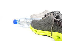 Sport shoes and water Stock Image